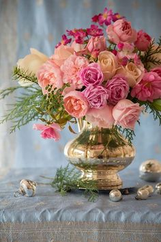 Silver vase and gawjous roses.. What more could a girl want? ..don't answer that..