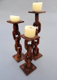 Rusted Chain Candle Holders SK212012-SK232012     These rustic yet contemporary candle holders provide warmth and charm to any space.    Using retired industrial chain and other discarded scraps, Shamus forms these amazing works of art.