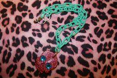 Bright Pink Glitter Skull Necklace.