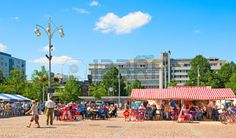 LAHTI, FINLAND - JULY 17, 2010: People rest and eat in cafes on Market Square in the center of Lahti. On the background is Alex Park Hotel photo