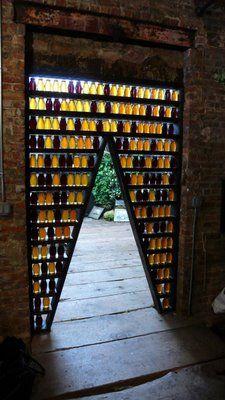 """The Hive Door"" by Derrick R. Cruz. 180 jars of pure raw local honey."