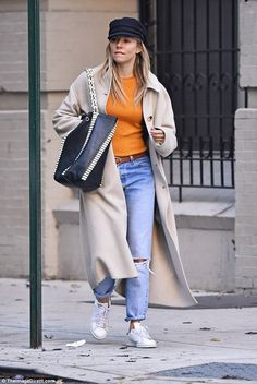 Warm this winter: Actress Sienna Miller, 35, was all wrapped up in an oversized ivory coat...