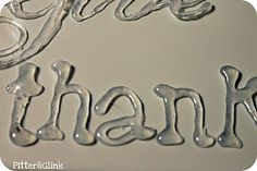 making letters with hot glue gun: wax paper, glue gun, dish soap, and printed words. Place the wax paper over the printed word,  cover wax paper with thin layer of dish soap mixed with a tiny bit of water.  Trace the letter outline with glue gun. After glue dries, peel off lettering...paint in any color.