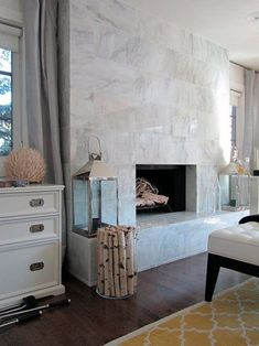 Fireplace Tiles - Design photos, ideas and inspiration. Amazing gallery of interior design and decorating ideas of Fireplace Tiles in bedrooms, living rooms by elite interior designers. Tiled Fireplace Wall, Fireplace Tile Surround, Home Fireplace, Marble Fireplaces, Fireplace Remodel, Fireplace Surrounds, Fireplace Design, Fireplace Mantels, Fireplace Modern