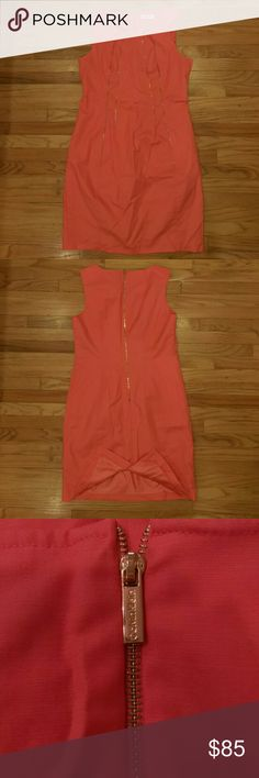 Calvin Klein very sheik salmon organge with gold worn once perfect condition  size 12 no stretch  beautiful  color with bright gold zipper embellished fully lined thick material great  for any occasion Calvin Klein Dresses Midi