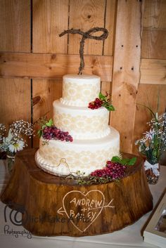 my winery wedding cake..wooden stump served as the cake stand