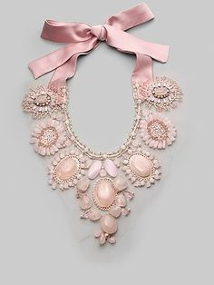 Statement necklace - pink stones and bow.
