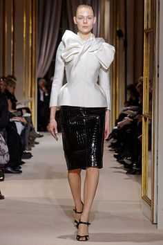 Valli Couture S12.  Like a dark twisted Dior New Look Suit.