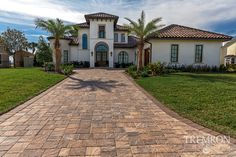 Pull up in style in your driveway with Tremron Stonehurst pavers in Sierra. Driveway Pavers, Driveway Design, Brick Pavers, Florida Georgia, Tampa Florida, Hardscape Design, Orlando, Outdoor Living, Backyard