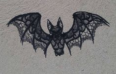 This lovely bat is stitched out with three freestanding lace pieces, then put…