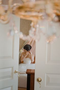 Putting on the wedding jewelry and finishing touches.Vendor Credit: Venue: Paris Hotel Las Vegas and Chateau |Las Vegas Wedding Planner Andrea Eppolito | Photo: Adam Frazier Photography | Decor: Naakiti Floral | Beauty: Make Up in the 702