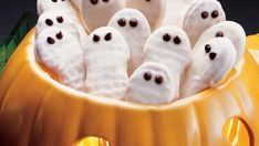 Frightfully Easy Ghost Cookies by pillsbury: Made with packaged peanut butter-filled sandwich cookies, candy coating and mini chocolate chips. #Cookies #Halloween #Ghost #Easy