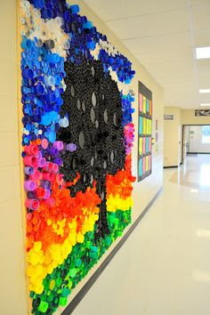 bottle cap mural, over 24,000 bottle caps of all shapes, sizes and colors. Mounted on two plyboards.