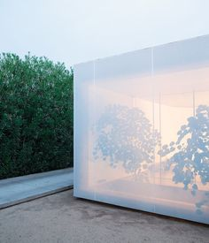 """The screen shifts between being opaque and semitransparent."" in the home of design firm, Atherton Keener in Phoenix, AZ"