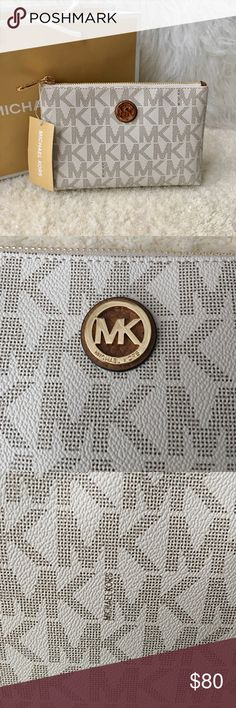 "NWT Michael Kors Pouch New with Tags. in Excellent Condition! Never used! Cream and gold tone travel pouch. Top zip closure. One slip pocket inside. Interior fully lined. H 5.25"", L 8"", W 2"". 💯 % AUTHENTIC! Comes with paper bag when purchase. Please see pictures. Michael Kors Bags"