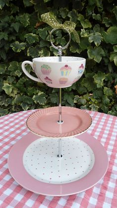cute cupcake stand!...I actually have a set of chocolate plates and mugs I bought years ago sitting in my kichen!!