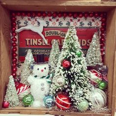 Vintage inspired cigar box winter shadow box. Bottle brush trees and snowman.