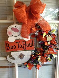Our new Halloween wreath. He's bootiful!