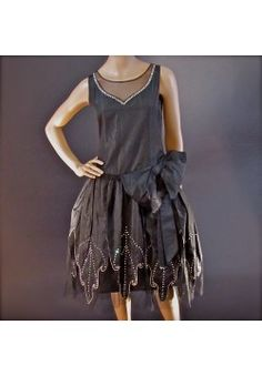 $4,800.00 - 1920's LANVIN Attributed Robe de Style Dress. An extremely rare 1920's era drop waist dress from France with authenticated attributes of a Lanvin original. Quintessential robe de style fitted with art deco leaf petal pattern w/ simulated diamonds. Sheer net sweetheart neckline. Right hip bow. (hva)