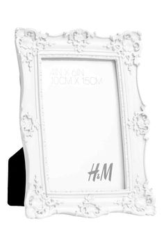 Photo frame: Richly decorated acrylic photo frame. Fits pictures up to approx. 10.5x15.5 cm.