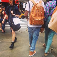 Does MCM stud their backpacks and do they make sneakers?
