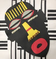 African mask with weaving background
