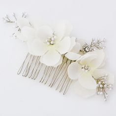 Elle & Jae Bridal Hair Combs & Bridal Accessories. Soft, delicate ivory flower hair comb with sprays of delicate pearls. Boho glamour.  https://perfectdetails.com/Elle-and-jae-433.htm