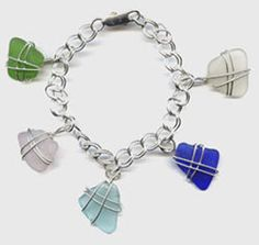 Sterling SeaGlass Charm Bracelet - This original, handcrafted jewelry is created from an exclusive collection of Cape Cod sea glass or grey beachstones found over the past 40 years. Each piece, wrapped in Sterling Silver, is hand-selected and ocean-made. As a result, variations will occur and are part of the natural beauty and originality of each item.