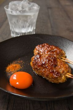 Tsukune, a type of yakitori, is a lightly seasoned mixture of chopped chicken formed into a sausage before being grilled and glazed with a sweet and savory taré.