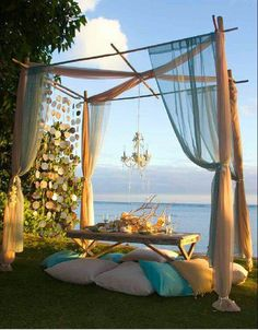 Gorgeous outdoor picnic under a bamboo DIY canopy draped in muslin gauzy sheers . Gorgeous outdoor picnic under a bamboo DIY canopy draped in muslin gauzy sheers with chandelier suspended, an Outdoor Curtains, Outdoor Rooms, Outdoor Dining, Outdoor Gardens, Outdoor Decor, Outdoor Lounge, Outdoor Seating, Romantic Dinner Tables, Romantic Dinners