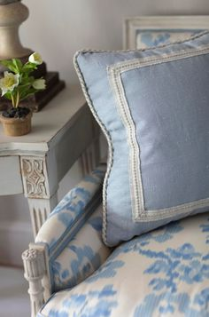 Pillow design but with darker fabric.  Love the Ikat fabric on the chair.  Brunschwig and Fils.  Designer Sallie Giordano - Tradtional home online 6/26/2014.