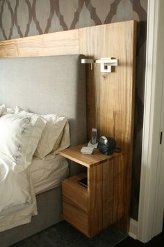 Custom headboard with nightstands and sonces