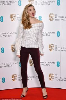 Pretty in pinstripes: Natalie Dormer beams in a stunning striped wrap top and red velvet t...