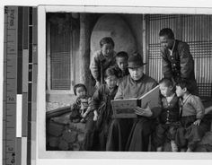 Father Carroll reads to group of Korean children, Anshu, Korea, ca. 1930-1939 :: International Mission Photography Archive, ca.1860-ca.1960
