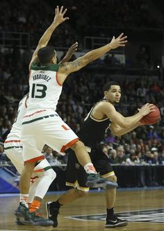 Wichita State guard Fred VanVleet looks to make a pass while Miami guard Angel Rodriguez defends during the second half at Dunkin Donuts Arena on Saturday.