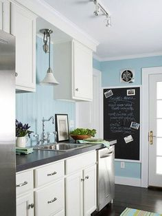 White kitchen & Black countertop - Pale blue is a cheery accent color for a cottage-style kitchen! See the rest of this kitchen makeover: BHG kitchen Stock Kitchen Cabinets, Kitchen Cabinet Hardware, Kitchen Redo, New Kitchen, Kitchen Dining, Kitchen Ideas, Kitchen Paint, Kitchen White, Kitchen Photos