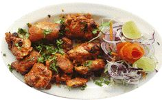 lahori-tikka Ing  1 kg chicken thighs 3 tblsp ginger garlic  1 tsp salt 2 fresh lemons 300g grated English cheese 300g yoghurt  ½Half kg single cream 1 or 2 eggs  3 tblsp black pepper 4 green chillis (cut into small pieces) ½Half bunch fresh coriander Method Mix the ginger, garlic, salt and lemon juice to make a marinade and leave the chicken in it for 30-40 minutes. Then add the cheese, yoghurt, cream, eggs, black pepper and chillis and marinate for another hour before grilling the chicken.