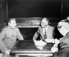 """LC-USZ62-113220: Yalta Conference, February 4-11 1945. Premier Marshal Joseph Stalin, (left), and President Franklin D. Roosevelt, (right), seated at table during the Yalta Conference. Scene of the """"Big Three"""" conversations at which military plans for the final defeat of Germany were decided. Office of War Information Photograph."""
