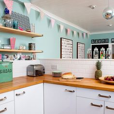 I love the kitchen, even the blue walls. Though I'm not such a fan of the decor (a little girly for me) - fuchsiadarling