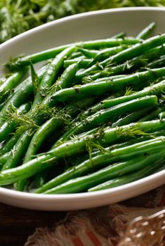 Steamed green beans served with a button of butter make for a perfectly acceptable side dish, but if you're looking to elevate the green bean to company-worthy status (with almost no more effort), here's your recipe. Just blanch the beans for a few minutes, toss with butter, chopped fresh dill and a grind or two of black pepper. (Photo:  Craig Lee for The New York Times)