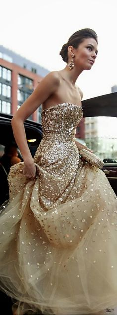 Such a gorgeous sparkling strapless gold gown for a fun reception dress