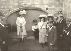 Grand Duchess Olga, Tsarevich Alexei, Grand Duchesses Tatiana, Maria, & Tsar Nicholas II. Dr Yevegneii Botkin who was later murdered with the Imperial family stands behind the Tsar. (The man to the far right looks an awful lot like King George V. This may be during the Imperial family's visit to England in 1909)