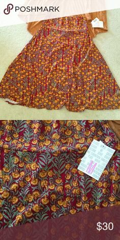 NWT M Lularoe Azure Pretty floral pattern. Slinky material. Matches the S NWTA Lindsay in my closet perfectly! Bundle both for a discount! LuLaRoe Skirts A-Line or Full