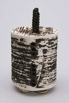 Ceramics by Dianne Cross at Studiopottery.co.uk - White and Black slab built box . H 20cm (inc. motif) W 10cm, 2007.