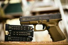 Gen 4 Glock 19... Not a big Glock fan but i love how the pistol & magazines are arranged in this picture!