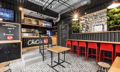mode:lina transformed a shipping container into a chic burger cafe called ChiChi 4U in Poznan, Poland.