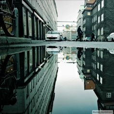 The beautiful city of Copenhagen is captured both in its �real� image and its reflection through rainy day puddles in an Instagram series called