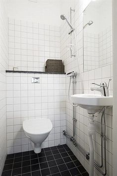 Small Bathroom Ideas With Small White Hanging Toilets Combine With White Checkered Tile Wall And Black Checkered Tile Floor