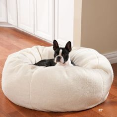 Ultra-Soft Plush Berber Slumber Ball...Or I can be nice and get her the ultimate bed since apparently her beds aren't good enough for her.  -_-