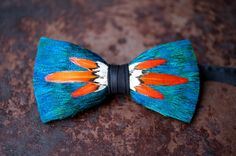 """""""For the man that's seeking a Brackish bow tie with a tad more dash than normal."""" Bloom. (handcrafted, one feather at a time by Brackish Bow Ties)"""